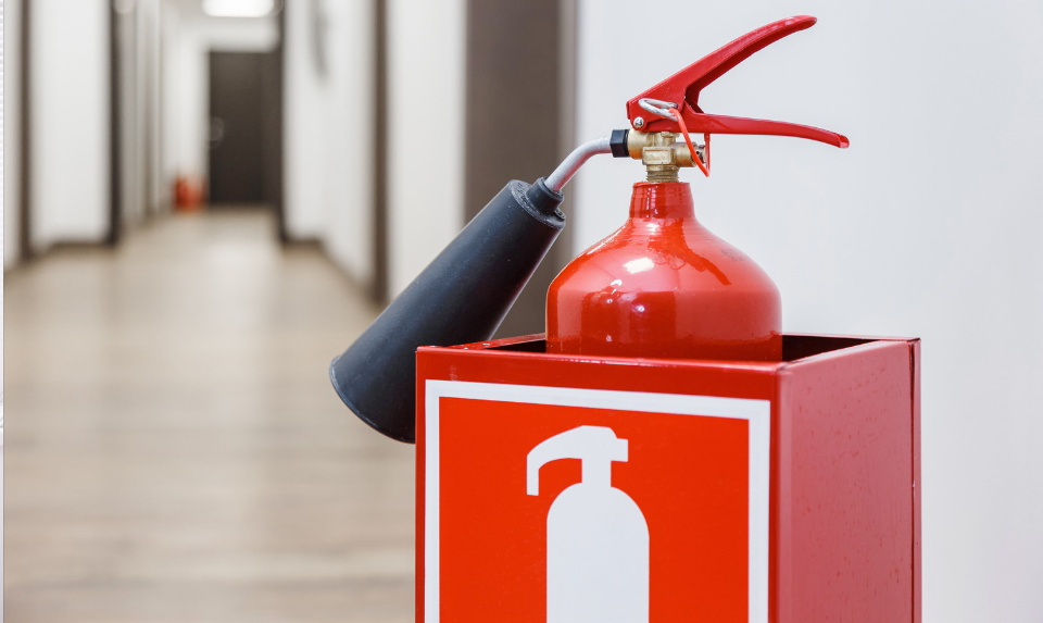 A fire extinguisher must be placed in accessible places, like in the hallway.
